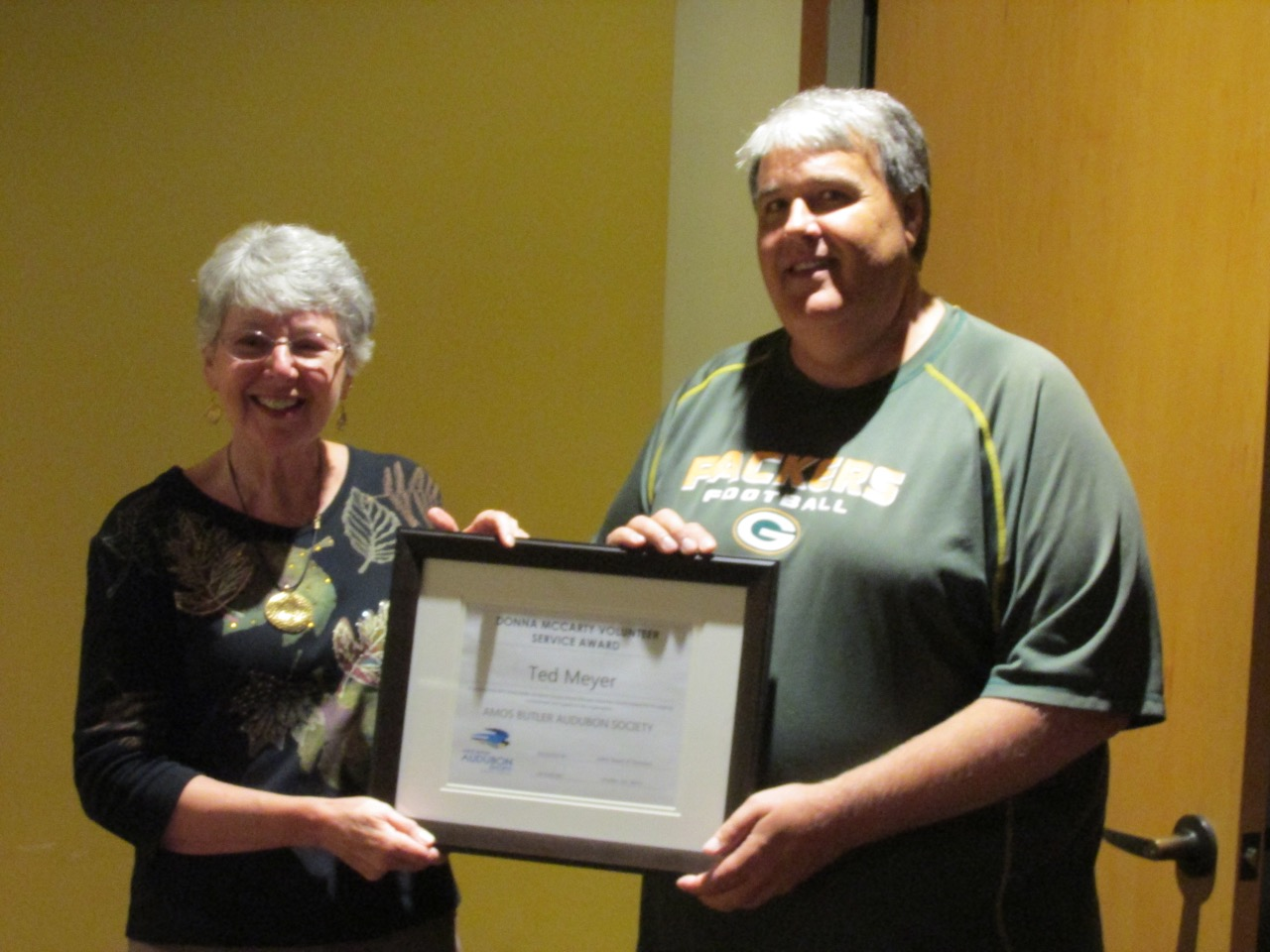 Ted Meyer accepting award from Donna McCarty