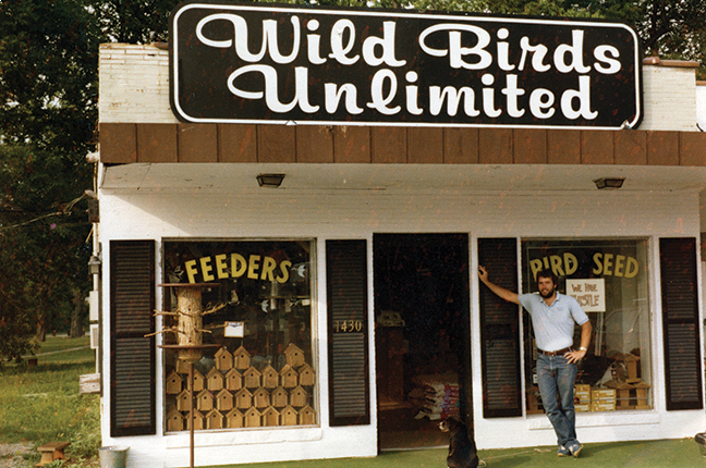 35 year old picture of Jim Carpenter in front of his first store